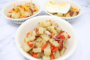 bacon breakfast hash in a white bowl