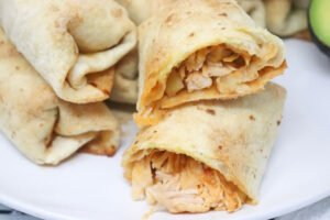 oven baked chimichangas on white plate