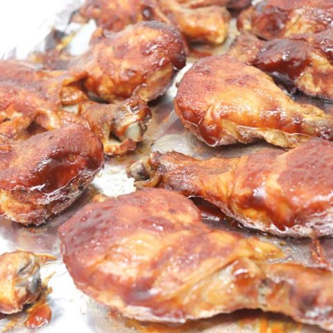 slow cooker bbq chicken cooked on a foil lined baking sheet close up