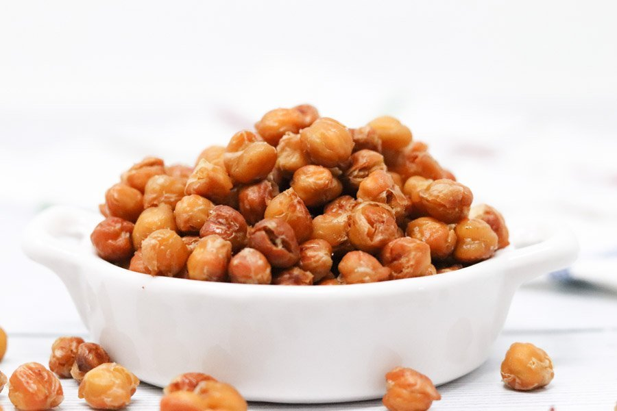 crispy chickpeas in a white dish close up side view