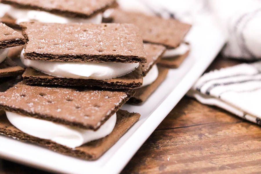 graham cracker sandwiches stacked on a white plate