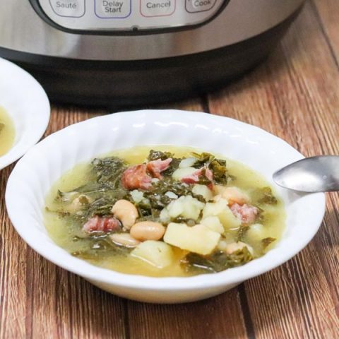 potato kale soup with a spoon close up in front of an instant pot