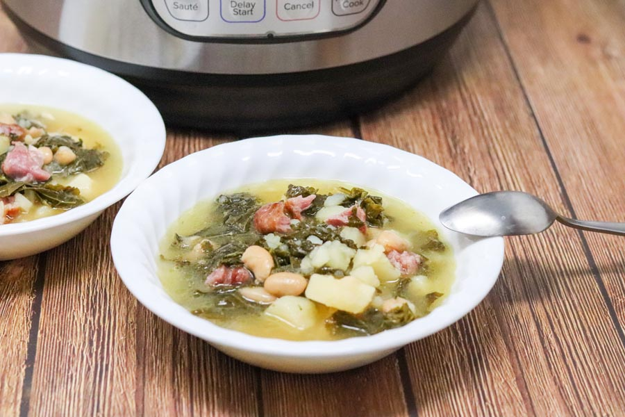 soup in a bowl with a spoon in front of the instant pot
