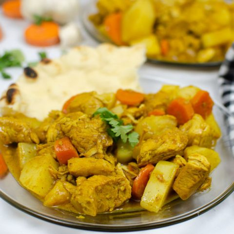 chicken curry on a glass plate