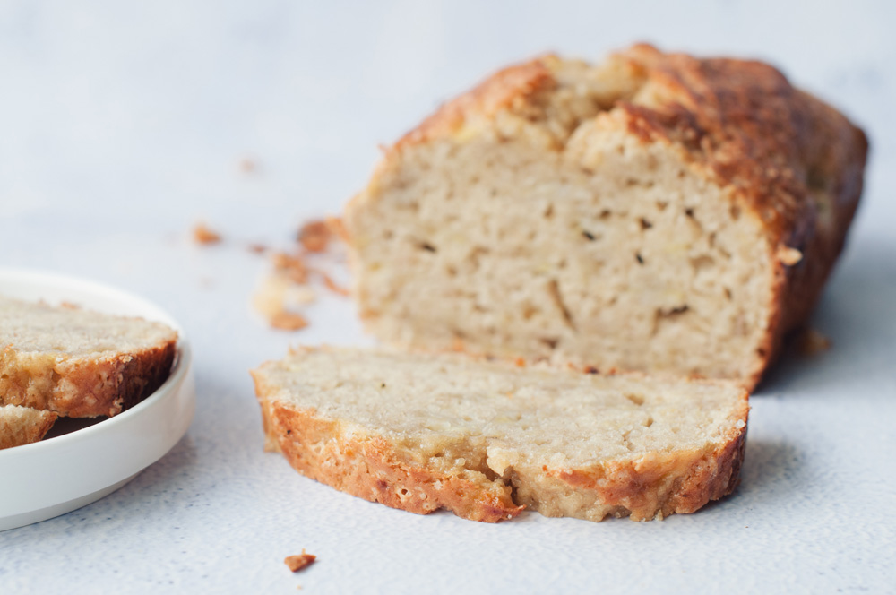 slice of banana bread on a loaf